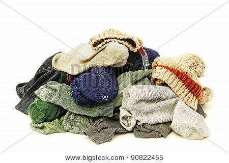 A lot of used socks isolated on white