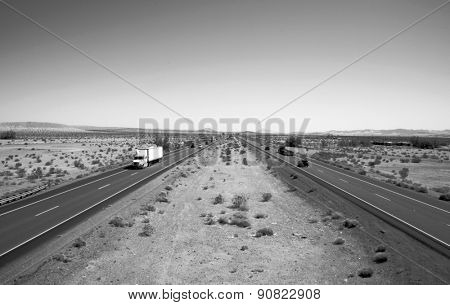 Unique View of the Interstate 15 Freeway from an overpass heading North towards Las Vegas, Nevada and South towards Los Angeles California. I15 is the main freeway between Las Vegas and Los Angeles