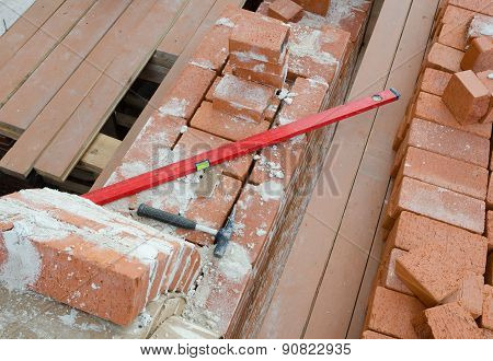 Mason Bricklaying Background With  Level, Hammer And  Brick Blocks