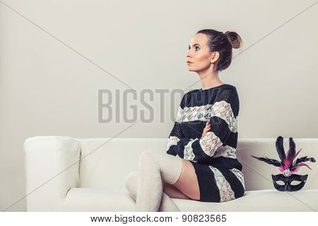 Woman With Carnival Mask Sitting On Sofa