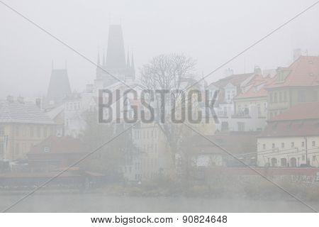 Morning fog over medieval houses in the Little Quarter in Prague, Czech Republic.