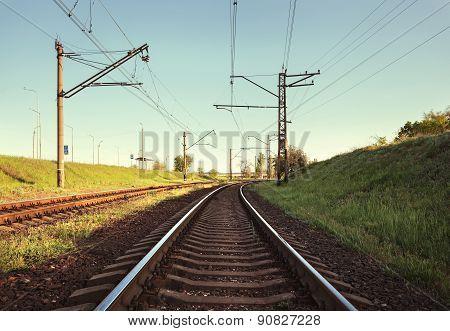 Cargo train platform at sunset. Railroad in Ukraine. Railway station