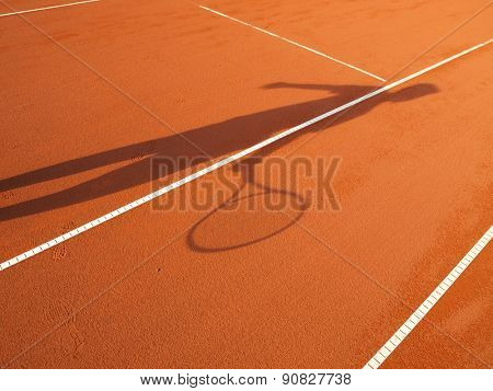 shadow of a tennis player in action on a tennis court (conceptual image)