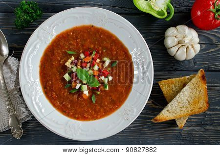 Fresh Gazpacho On A Wooden Table