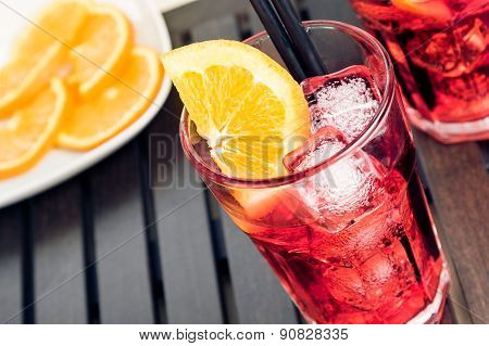 Top Of View Of Glasses Of Spritz Aperitif Aperol Cocktail With Orange Slices And Ice Cubes Near Plat