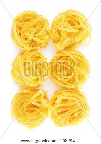 Tagliatelle italian pasta isolated on white background