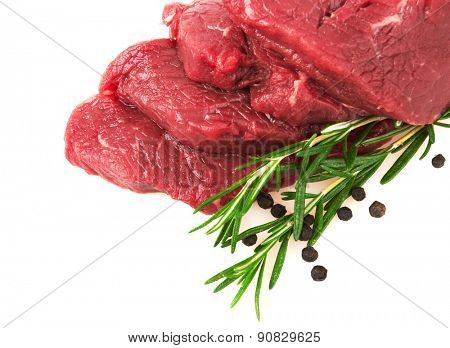 Fresh Raw Meat with pepper and rosemary, isolated on white background
