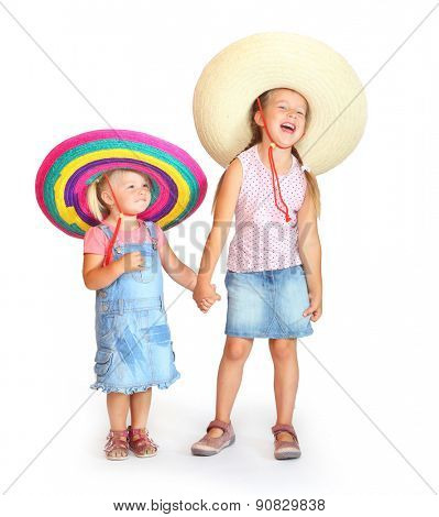 Little girls in mexican sombrero have a fun.