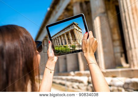 Woman photographing Hephaistos temple in Agora