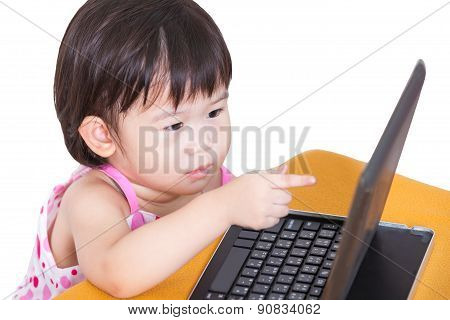 Little Asian (thai) Girl Pointing At Tablet Computer. Isolated On White
