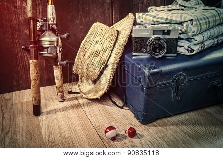 Travel theme still life with vintage items and fishing poles