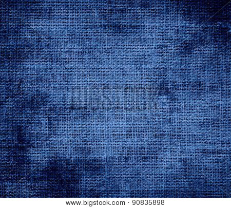 Grunge background of dazzled blue burlap texture
