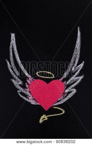 paper heart with pictured chalk wings on black background