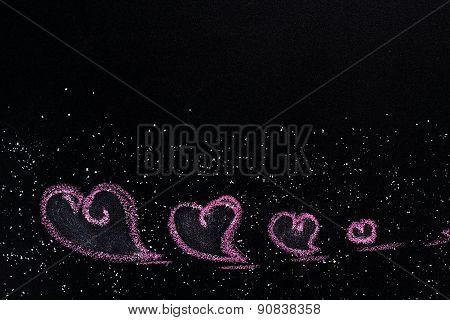 hearts, drawn in chalk on dark background