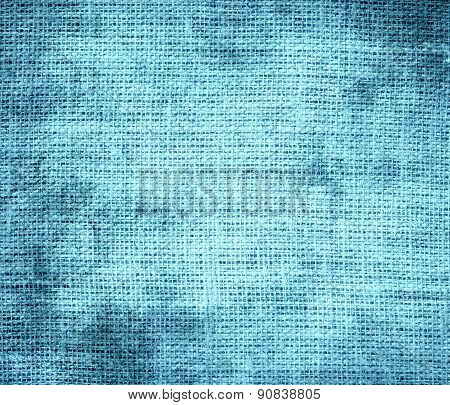 Grunge background of blizzard blue burlap texture