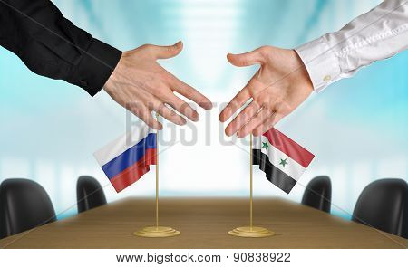 Russia and Syria diplomats agreeing on a deal