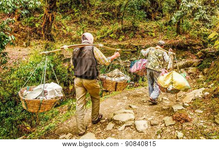 Man In Nepal  Carrying A Big Heavy Load On Their Shoulders