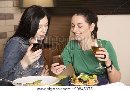 Two women using a smart phone