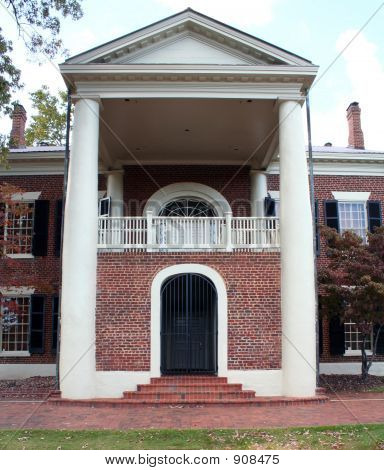 Red Brick And White Pillars
