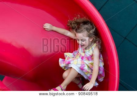 Sliding On Playground