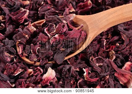 Dried Petals Of Hibiscus In A Wooden Spoon