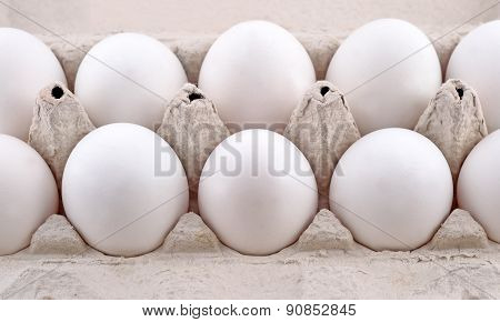 Eggs In A Cardboard Box On A White