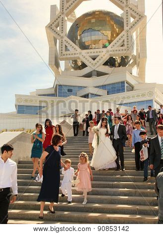 Ashgabad, Turkmenistan - May 15, 2013. Bride And Groom On The Steps Of The Palace Of Marriages.  Ash