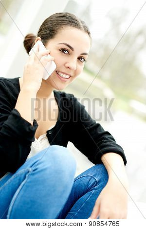 Young Woman Taking A Call On Her Mobile
