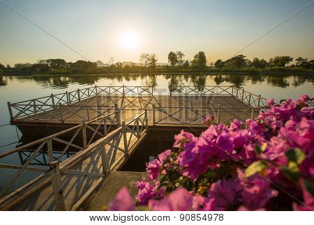 Pier with flowers at sunset. Kanchanaburi, Thailand