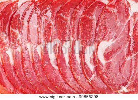 Sliced prosciutto ham macro texture