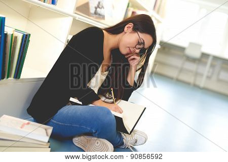 Young Woman Working In A College Library