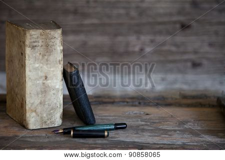 Old Books And Fountain Pen With Wooden Background