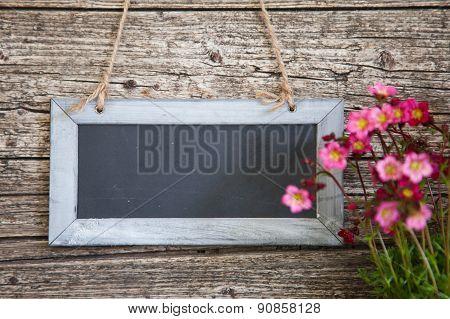 Blank Rectangular Blackboard On Rustic Wooden Wall