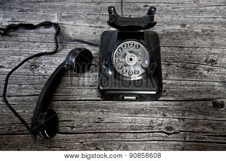 Black Rotary Telephone With The Receiver Off-hook