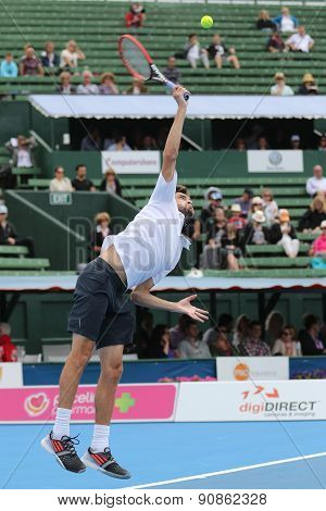 Gilles Simon of France makes Contact hitting a Serve