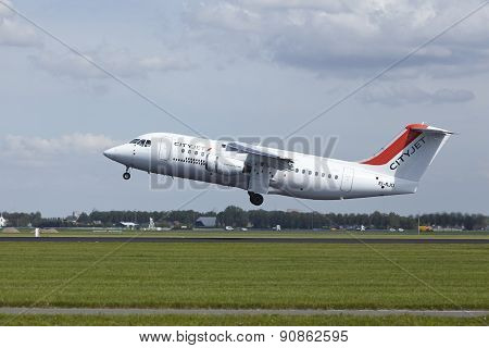 Amsterdam Airport Schiphol - Avro Rj85 Of Cityjet Takes Off