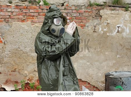 Man With Gas Mask And Green Military Clothes  Explores  Small Plant  After Chemical Disaster.