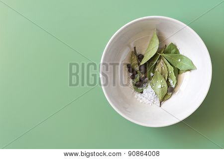 Spices in a bowl, top view