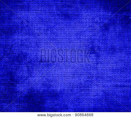 Grunge background of bluebonnet burlap texture