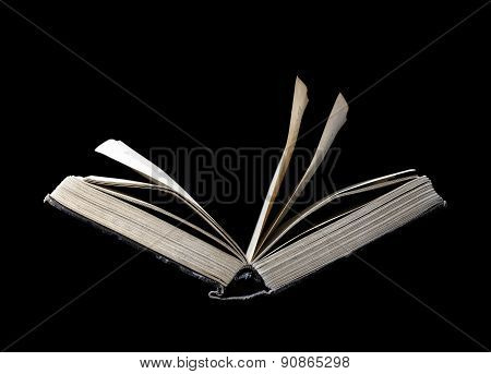 Old Open Book Isolated On A Black Background