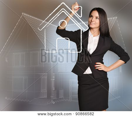 Woman draws house icon standing on background scheme cottage