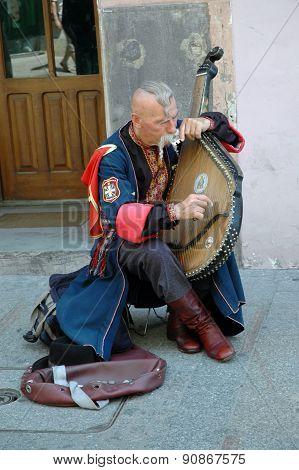 Ukrainian Cossak Playing On His Bandura