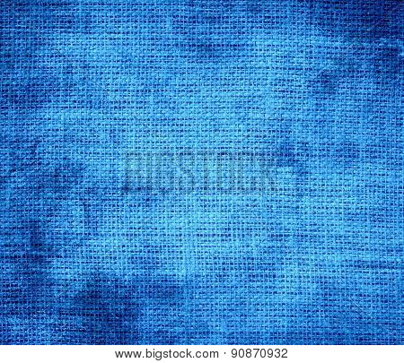 Grunge background of brilliant azure burlap texture