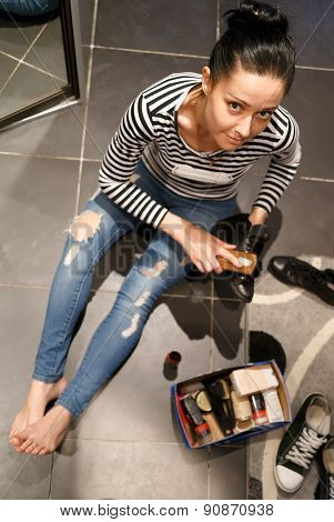Woman sits on floor