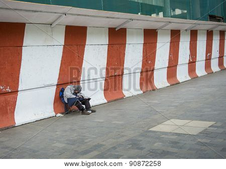 TBILISI, GEORGIA - MAY 01, 2015: A homeless man sleeping on the street