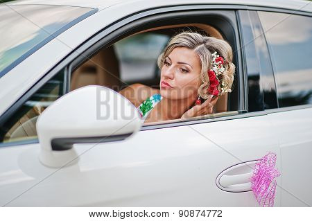 Wedding Beautiful Bride In Traditional Dress In Exotic Supercar Looked At The Mirror
