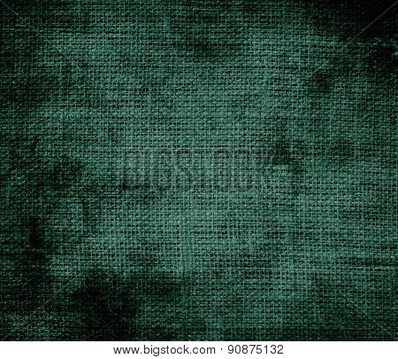 Grunge background of brunswick green burlap texture