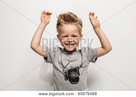 Portrait of happy joyful beautiful little boy