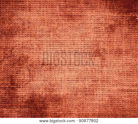 Grunge background of burnt sienna burlap texture