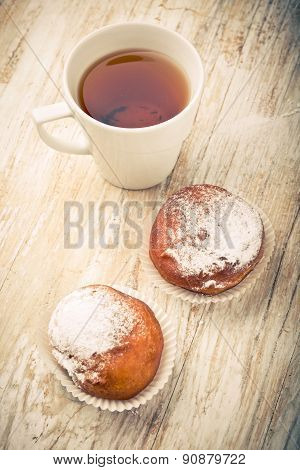 Vintage Photo Of Homemade Donuts And Cup Of Tea